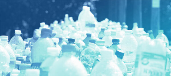 plastic bottles lined up for recycling, with blue overlay